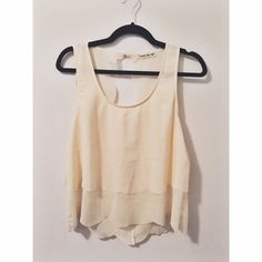 Double Zero Scalloped Cream Open Back Tank Light cream tank with scalloped edges and an open back. Button at the back of the neck to keep it on. A little on the short side, so I pair it with high waisted pants or shorts. Double Zero Tops Tank Tops