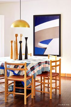 Modern dining space with plaid table cloth and beautiful art