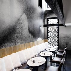 Swirling textured two-tone amorphous patterns sensually surround the diner, cut through with honeycombs, edges and cracked reflective surfaces which add further visual interest...