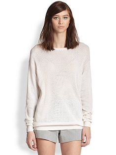 Take a luxe approach to sporty style in this cool yet understated perforated cotton and silk sweater.Semisheer perforated styleRibbed round neckline cuffs and hemDropped shouldersLong dolman sleevesPullover styleAbout 28 from shoulder to hemCottonsilkDry cleanImported of Italian fabric #Fashion  #SaksFifthAvenue