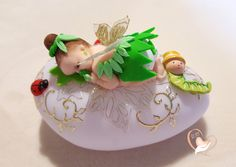 Nightlight Pebble bright baby girl Tinker Bell - the heart of the arts Baby Cupcake Toppers, Fondant Toppers, Baby Shower Cupcakes, Baby Shower Themes, Baby Girl Purple, Book Cupcakes, Handmade Wedding Favours, Fondant Baby, Clay Baby