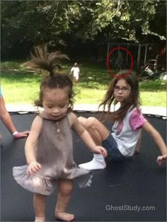ghost in the backyard!what's even creepier is that the little girl on the right looks identical to my 11 yr old daughter! *o* lol