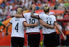 Germany's Leonie Maier, Alexandra Popp and Anja Mittag...