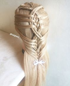I would kick the bow and tie it off at the last cross over of the fishtail braids before the last bring in in of hair