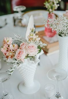 White vintage vases for centerpieces florals. Photography: Amanda Basteen Read More: http://www.stylemepretty.com/2014/09/19/iowa-backyard-barn-wedding/