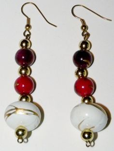"""Multi-beaded Drops $6.95  Red, cream and white marbled gold colored beaded drop earrings. Handmade and one of a kind. Perfect to wear from the office to cocktail hour. 3"""" total drop length. #earrings #accessories #fashion #jewelry"""