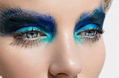 Peacock feather blue and turquoise eye makeup. Love how it reflects her eye colour