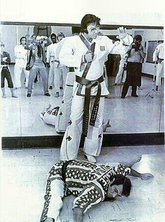 Elvis showing people his karate with 'Superfoot' Bill Wallace as his helper