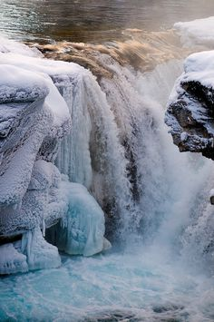 I'm not quite ready for winter yet, but just look at this frozen waterfall.
