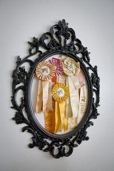 Cute display idea for vintage equestrian ribbons. via http://www.flickr.com/photos/71112133@N00/sets/72157622837922576/