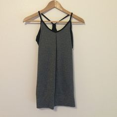 Champion workout tank/bra attached. Size S. Basically brand new workout shirt with attached bra for convenience :) pretty racer back. Champion Tops Tank Tops