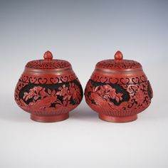 Lot #226: Cinnabar Lidded Bowls DESCRIPTION: Pair of Chinese hand carved cinnabar lidded bowl features a black ground color with a bred cinnabar overlay depicting floral decorations.  CIRCA: 20th Ct. ORIGIN: China DIMENSIONS: H: 7″ L: 4.5″