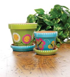 Spring Clay Pots; Show off your Spring flowers in these fun, bright colorful clay pots. Better yet, make one for a friend and brighten their day!    Courtesy of the Plaid Creative Team.  http://www.michaels.com/spring-clay-pots/28717,default,pd.html
