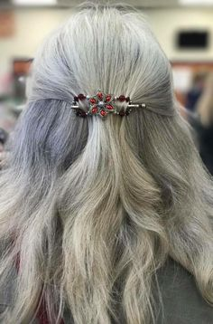 Gorgeous Poinsettia flexi clip in silver white hair. Quick and easy half up style with this beauty and you instantly have holiday festivities ready hair! Ladies love Lilla Rose accessories!