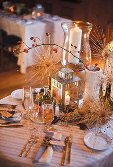 A wedding centerpiece, but the little tin lanterns are oh so cute!