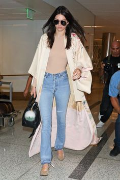 Kendall was spotted at LAX airport wearing a tan bodysuit with jeans, a printed kimono, and nude pumps. Okay, maybe the jeans not so much, but the rest of the look is pretty classic Kim K.    - MarieClaire.com