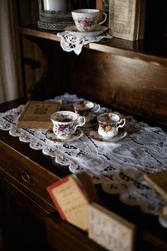 tea cups and vintage books