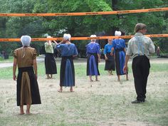 Amish teenagers playing volleyball in PA, note the bonnet ties and back of dresses w/ aprons.