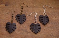 These beautiful earrings are hand made from recycled bicycle inner tubes. Each pair is hand crafted and unique. Length of Leaf: 2cm (20mm) Different designs available and we are happy to custom make if you have something in mind. Also available with silver plated hooks. Delivery is