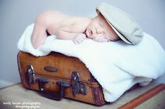 antique suitcase news boy hat ... oh and a baby!