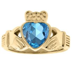 Blue Topaz Birthstone Heart Irish Claddagh Symbol Wedding Ring In Yellow Gold Available Exclusively at Gemologica.com silver claddagh ring birthstone diamond claddagh ring claddagh wedding ring claddagh ring with birthstone FINE JEWELRY AT GEMOLOGICA.COM