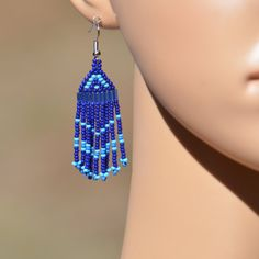 Pretty blue dangling seed bead earrings. Handmad by VickiDesignsCA on Etsy