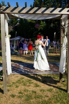 An outdoor rug served as a dance floor that was easily moved into the shade after the ceremony. The arbor was purchased off craigslist for $50.