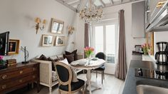 This charming studio apartment rental in Paris is a little jewel, with beautiful decor and picture perfect views of the Eiffel Tower.