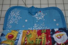 Gotta try this for next year....button placement for hanging potholder dish towel