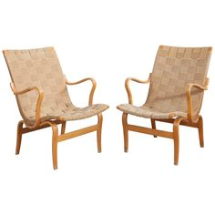 Pair of Bruno Mathsson Eva Chairs | From a unique collection of antique and modern armchairs at https://www.1stdibs.com/furniture/seating/armchairs/