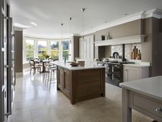 This Arts & Crafts style Surrey house has undergone a radical transformation with dated, fussy decor being replaced by a new linear design with minimal, but well-considered decorative detailing. ⠀⠀ 'Edessa' limestone floor from Martin Moore Stone. Bespoke Kitchens, Luxury Kitchens, Limestone Flooring, English Kitchens, Island Design, Beautiful Kitchens, Minimalism, Kitchen Design, Surrey