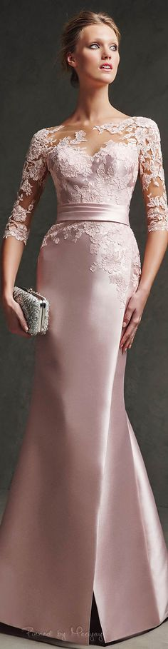 Lovely rose colored dress with sheer lace sleeves. The haute couture 3/4 sleeve evening gown can be made to order by our US dress design firm at an affordable cost. We specialize in replicas and inexpensive custom formal gowns. https://www.dariuscordell.com/featured/custom-made-mother-of-the-bride-evening-dresses/