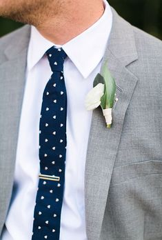Brides: White Ranunculus Boutonniere with Greens. A classic white ranunculus boutonniere created by Oh Deery Florals.
