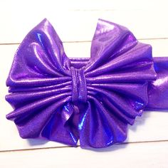 A personal favorite from my Etsy shop https://www.etsy.com/listing/236681032/shinny-bright-purple-floppy-bow-on-a