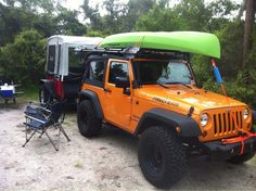 "Gobi stealth roof rack with Kayak (photo credit goes to ""DougM"" for sharing on JK-Forum.com).  Note this also gives a little shot of the Jeep tow-able tent trailer."