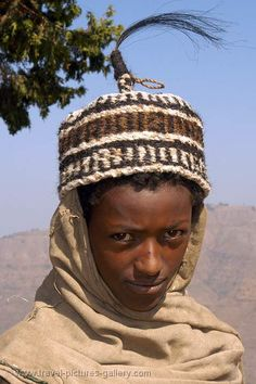 wearing a hat made of goat's hair, mountains near Lalibela