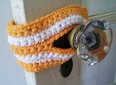 Good stash-buster for leftover yarn. Can be made with one color. Can be embellished or left plain. Can be adapted for unusual doorknob placements or dimensions.