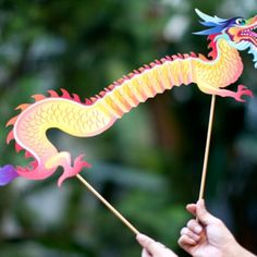 Chinese New Year Dragon Puppet - This easy-to-assemble printable dragon puppet will be a big hit at your party.  Free Download - Chinese New Year Dragon Puppet Template