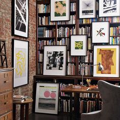 my dream office... love all the books and artwork hanging from the shelves.
