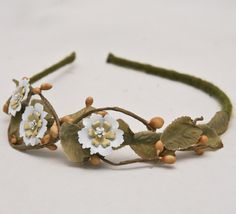 flower child, vintage daisy headband for women. $40.00, via Etsy.