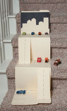 Folder parking garage for toy cars. So clever!