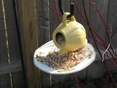 Hanging Tea Cup Bird Feeder | filled the whole tea pot with food. Its so cute to watch them stick ...