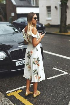 Photos via: Nina Suess Nina has us coveting a cold-shoulder floral print dress to wear for the rest of the summer. Pair it with metallic gold loafers and you've instantly got yourself a feminine, yet
