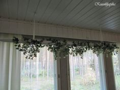 paint an old hay pole white, hang it and cover it with plants. During the winter change LED lights onto it. Via blog Kuunliljapiha
