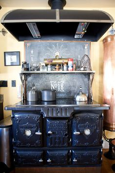 This cast iron cooking stove from the 1800s is Bruce's ultimate prized possession. The Mott's Defiance Stove was modernized with a Miele glass cooktop and two new ovens by Erickson's Antique Stoves.
