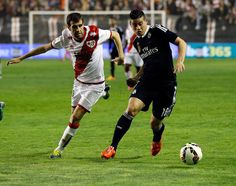 James Rodríguez of Real Madrid CF competes for the ball against of Rayo Vallecano de Madrid during the La Liga match between Rayo Vallecano de Madrid and Real Madrid CF at Vallecas Stadium on April 8, 2015 in Madrid, Spain.