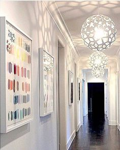 Three sparkling white CORAL pendant lights lining this beautiful hallway make us think of spring. Click image for where to buy.