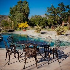 Haitian 7 Piece Dining Set by NFusion. $1059.99. 230488 With Haitian Cast Aluminum outdoor dining set, you can comfortably seat up to 6 guests in the warmth of your backyard or deck. Its sturdy build and intricate design will offer years of sheer pleasure. Features: -Set includes: 6 chairs and 1 table. -Sturdy construction. -Neutral colors to match any outdoor decor.