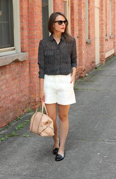 Penny Pincher Fashion-Classic Chic  creme shorts and black patterned blouse with loafers