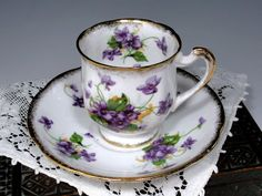 Sweet vintage demitasse tea cup and saucer set by Royal Standard, English fine bone china. Purple wild violets over snow white china,